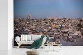 Fotobehang vinyl - Skyline van Damascus onder blauwe hemel in Syrië breedte 420 cm x hoogte 280 cm - Foto print op behang (in 7 formaten beschikbaar)