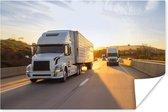 Poster - Twee vrachtwagens met een zonsondergang - 60x40 cm