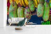 Fotobehang vinyl - Vrolijk gekleurd jackfruit in Maleisië op een markt breedte 605 cm x hoogte 340 cm - Foto print op behang (in 7 formaten beschikbaar)