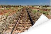 Een spoorweg gefotografeerd tijdens een zonnige middag Poster 120x80 cm - Foto print op Poster (wanddecoratie woonkamer / slaapkamer)