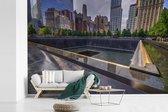Mooie zonnestralen op het September 11 Memorial fotobehang vinyl breedte 330 cm x hoogte 220 cm - Foto print op behang (in 7 formaten beschikbaar)