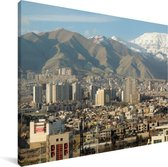 Plaatje van Teheran met bergen op de achtergrond in Iran Canvas 40x30 cm - klein - Foto print op Canvas schilderij (Wanddecoratie woonkamer / slaapkamer)