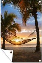 Tuinposter Jamaica - Hangmat op strand tijdens zonsondergang in Jamaica tuinposter los doek 60x90 cm - Tuindoek/Buitencanvas/Schilderijen voor buiten (tuin decoratie)