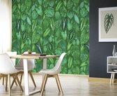 Tropische bladeren op groene achtergrond