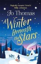 Boek cover A Winter Beneath the Stars van Jo Thomas