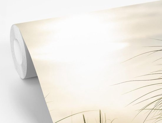 Fotobehang vinyl - Duinen met helmgras onder de zon van het Duitse nationaal Park Schleswig-Holsteinisches Wattenmeer fotobehang breedte 330 cm x hoogte 220 cm - Foto print op behang (in 7 formaten beschikbaar)