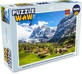 Puzzel 1000 stukjes volwassenen Eiger 1000 stukjes - Panoramisch zicht op het dorp Grindelwald en Wetterhorn in Zwitserland  - PuzzleWow heeft +100000 puzzels
