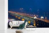 Fotobehang vinyl - Verlichting van de brug in Wuhan breedte 540 cm x hoogte 360 cm - Foto print op behang (in 7 formaten beschikbaar)
