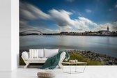 Fotobehang vinyl - Skyline van Nijmegen met een blauwe lucht breedte 330 cm x hoogte 220 cm - Foto print op behang (in 7 formaten beschikbaar)