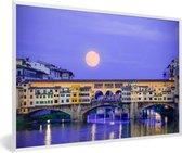 Foto in lijst - Volle maan boven de Ponte Vecchio in Florence fotolijst wit 60x40 cm - Poster in lijst (Wanddecoratie woonkamer / slaapkamer)