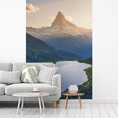 Fotobehang vinyl - Matterhorn en het meer Stellisee bij zonsondergang op Wallis in Zwitserland breedte 180 cm x hoogte 270 cm - Foto print op behang (in 7 formaten beschikbaar)