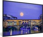 Foto in lijst - Volle maan boven de Ponte Vecchio in Florence fotolijst zwart 60x40 cm - Poster in lijst (Wanddecoratie woonkamer / slaapkamer)