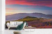 Fotobehang vinyl - Kleurrijke lucht boven het Nationaal park Caldera de Taburiente in Spanje breedte 595 cm x hoogte 380 cm - Foto print op behang (in 7 formaten beschikbaar)