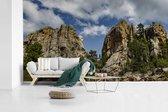 Fotobehang vinyl - Het Noord-Amerikaanse monument Mount Rushmore met een bewolkte hemel breedte 410 cm x hoogte 230 cm - Foto print op behang (in 7 formaten beschikbaar)