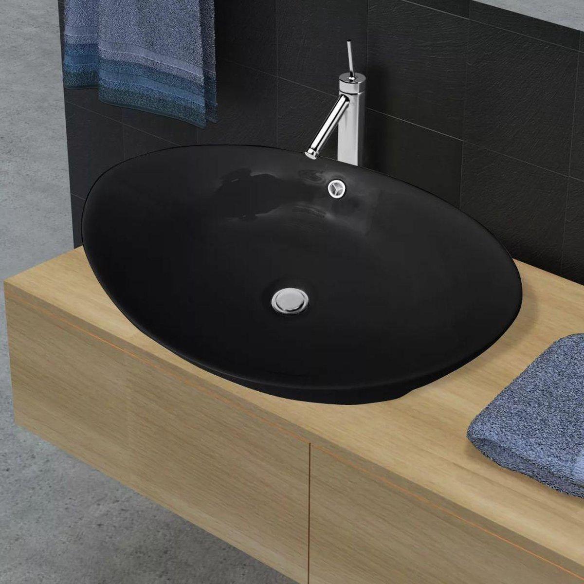 Wastafel met overloop zwart ovaal keramiek 59 x 38,5 cm