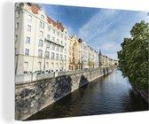 Historische gebouwen en bomen langs de rivier de Moldau Canvas 180x120 cm - Foto print op Canvas schilderij (Wanddecoratie woonkamer / slaapkamer) XXL / Groot formaat!