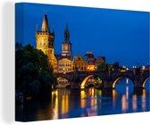 Karelsbrug in de nacht in Praag Canvas 180x120 cm - Foto print op Canvas schilderij (Wanddecoratie woonkamer / slaapkamer) XXL / Groot formaat!
