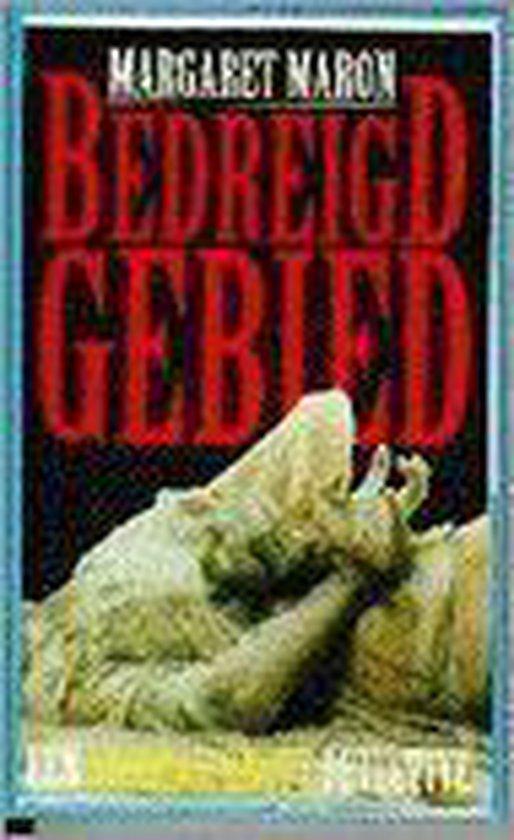 BEDREIGD GEBIED - Margaret Maron |