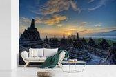 Unieke lucht boven de Borobudur tempel in Indonesië fotobehang vinyl breedte 390 cm x hoogte 260 cm - Foto print op behang (in 7 formaten beschikbaar)