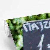 Fotobehang vinyl - Rode bieten te koop op de markt breedte 240 cm x hoogte 360 cm - Foto print op behang (in 7 formaten beschikbaar)