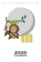 Owl sticked to tree in front of Moon Calendar 2020