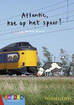 Toneellezen  -   Attentie, koe op het spoor!