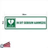 AED sticker. AED in dit gebouw aanwezig.