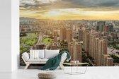 Woonblokken met zonsondergang in Hangzhou fotobehang vinyl breedte 540 cm x hoogte 360 cm - Foto print op behang (in 7 formaten beschikbaar)