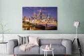 Skyline van Melbourne in de nacht Canvas 120x80 cm - Foto print op Canvas schilderij (Wanddecoratie woonkamer / slaapkamer)