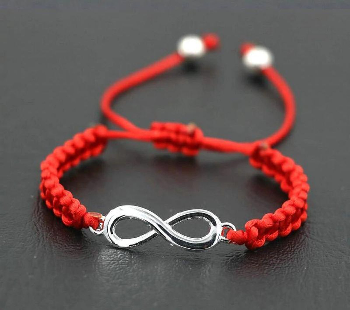 Rode armband hanger infinity