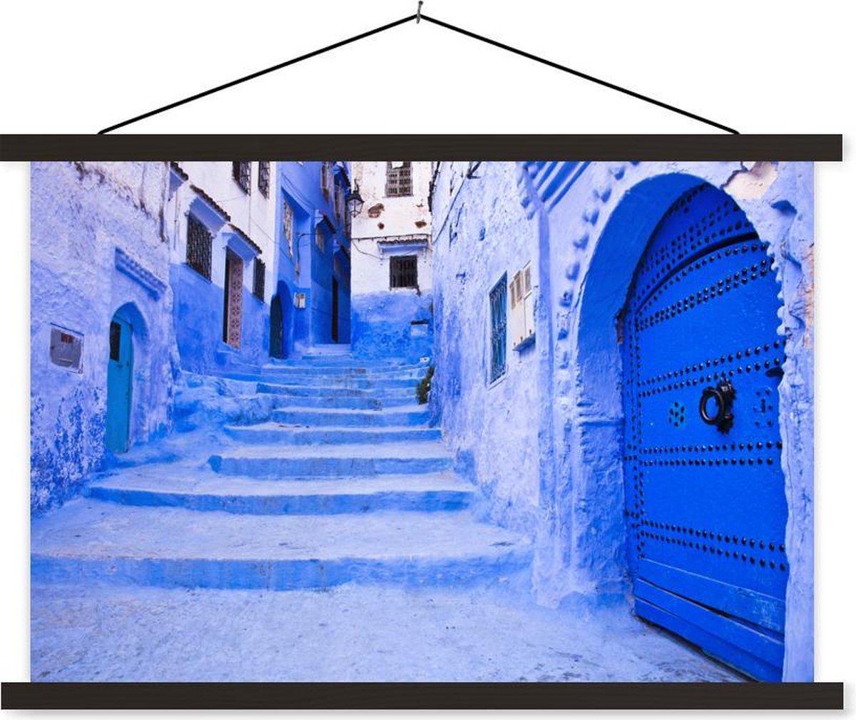 Blauwe huizen in Marokko textielposter latten zwart 150x100 cm - Foto print op schoolplaat (wanddecoratie woonkamer/slaapkamer)