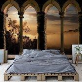Fotobehang Mountain Sunrise Stone Archway View   VEXXXL - 416cm x 254cm   130gr/m2 Vlies