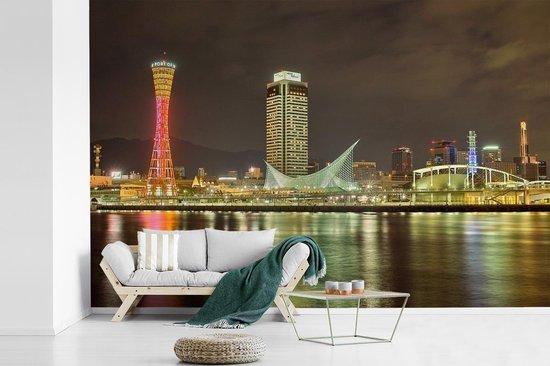 Fotobehang vinyl - Japanse wolkenkrabber in Kobe onder de avond lucht breedte 540 cm x hoogte 360 cm - Foto print op behang (in 7 formaten beschikbaar)