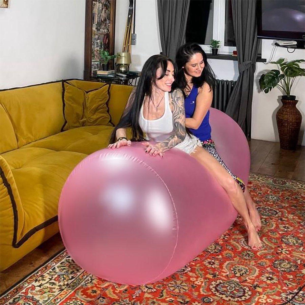 Opblaasbaar rond kussen 2 meter lang/ 70 cm hoog - kleur Roze