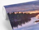 Fotobehang vinyl - Zonsondergang bij het Nationaal park Tiveden in Zweden breedte 600 cm x hoogte 400 cm - Foto print op behang (in 7 formaten beschikbaar)