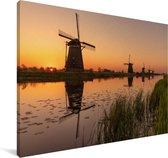Rode gloed in de lucht bij de Molens van Kinderdijk in Europa Canvas 180x120 cm - Foto print op Canvas schilderij (Wanddecoratie woonkamer / slaapkamer) XXL / Groot formaat!