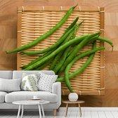 Fotobehang vinyl - Bos van verse sperziebonen op een bamboedienblad breedte 400 cm x hoogte 360 cm - Foto print op behang (in 7 formaten beschikbaar)