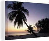 Zonsondergang aan de kust van Grand Cayman met prachtige palmbomen Canvas 140x90 cm - Foto print op Canvas schilderij (Wanddecoratie woonkamer / slaapkamer)
