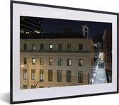 Foto in lijst - Gebouwen in het centrum van Tulsa in de Verenigde Staten tijdens de nacht fotolijst zwart met witte passe-partout klein 40x30 cm - Poster in lijst (Wanddecoratie woonkamer / slaapkamer)