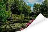 Zomerdag met waterlelies in het water in Monet's tuin in Frankrijk Poster 120x80 cm - Foto print op Poster (wanddecoratie woonkamer / slaapkamer)
