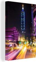 Verlichte Taipei 101 in Taiwan bij avond Canvas 90x140 cm - Foto print op Canvas schilderij (Wanddecoratie woonkamer / slaapkamer)