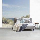 Duinen met de Noordzee op de achtergrond fotobehang / Zee en Strand