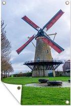 Wolken boven een windmolen in Zierikzee tuinposter los doek 120x180 cm - Tuindoek / Buitencanvas / Schilderijen voor buiten (tuin decoratie) XXL / Groot formaat!