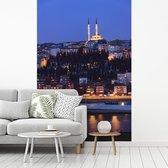 Uitzicht op Istanbul in de nacht fotobehang vinyl 215x320 cm - Foto print op behang
