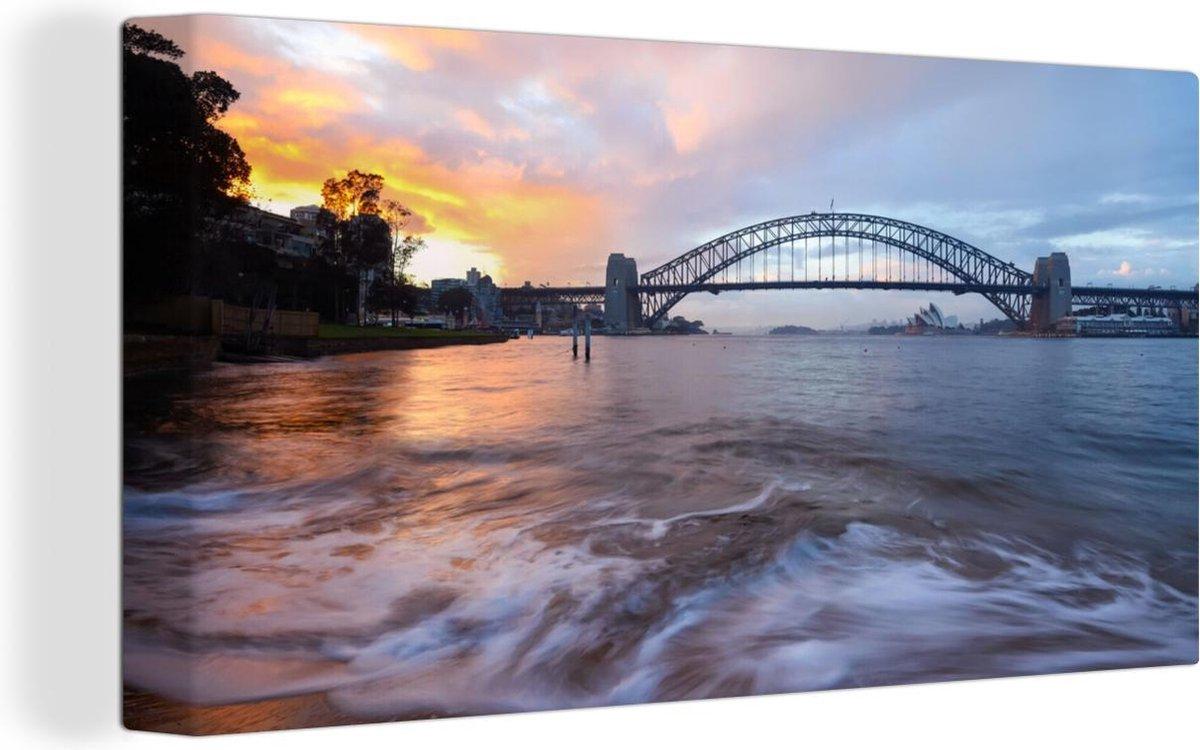 Canvas Schilderijen - Uitzicht over het water bij de Sydney Harbour Bridge in Australi  - 80x40 cm - Wanddecoratie