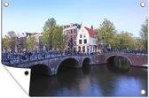 De Keizersgracht in Amsterdam onder een blauwe lucht 90x60 cm