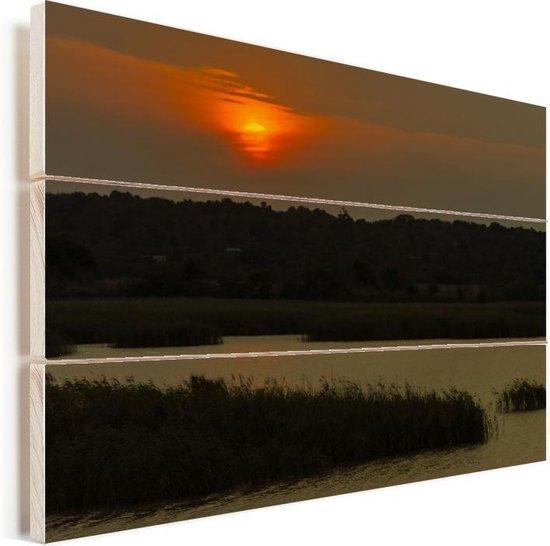 Zonsondergang in het iSimangaliso in Zuid-Afrika Vurenhout met planken 90x60 cm - Foto print op Hout (Wanddecoratie)