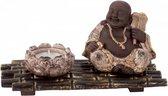 Buddha met theelichthouder op bamboe-look mat
