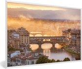 Foto in lijst - Mist dampen boven de Ponte Vecchio in Florence fotolijst wit 60x40 cm - Poster in lijst (Wanddecoratie woonkamer / slaapkamer)