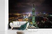 Fotobehang vinyl - Shenzhen verlicht in de nacht breedte 540 cm x hoogte 360 cm - Foto print op behang (in 7 formaten beschikbaar)